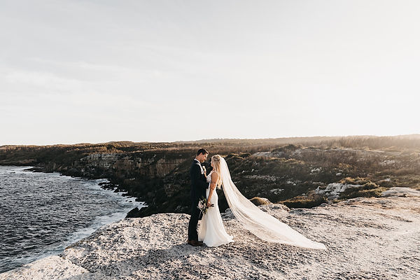 Couple standing on a cliff on the south coast in a national park for an elopement shot by matt ashton photography wedding and elopement photographer south coast illawarra wollongong southern highlands photographer