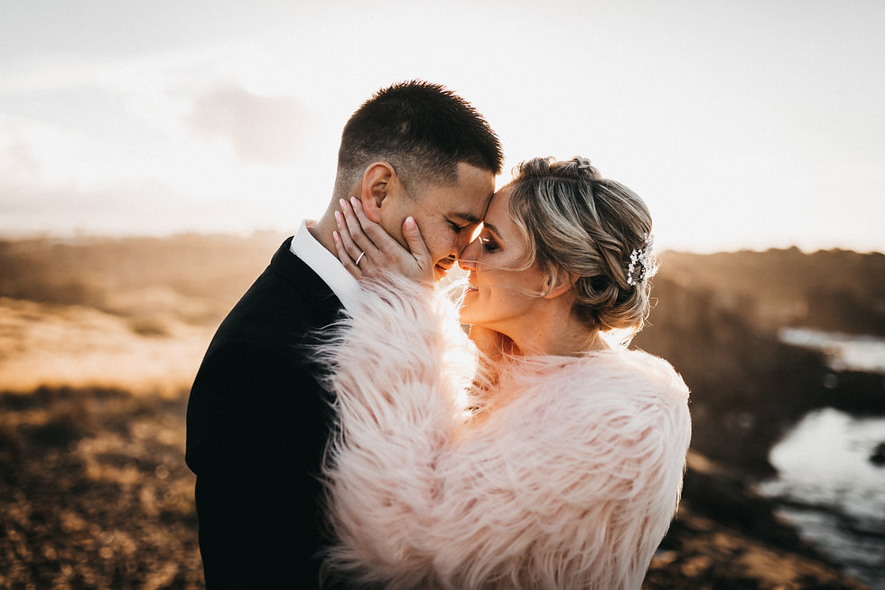 South Coast Elopement & Wedding Photographer Matt Ashton Photography a couple standing on a cliff at sunset