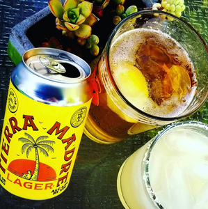 A can of craft lager and a margarita.
