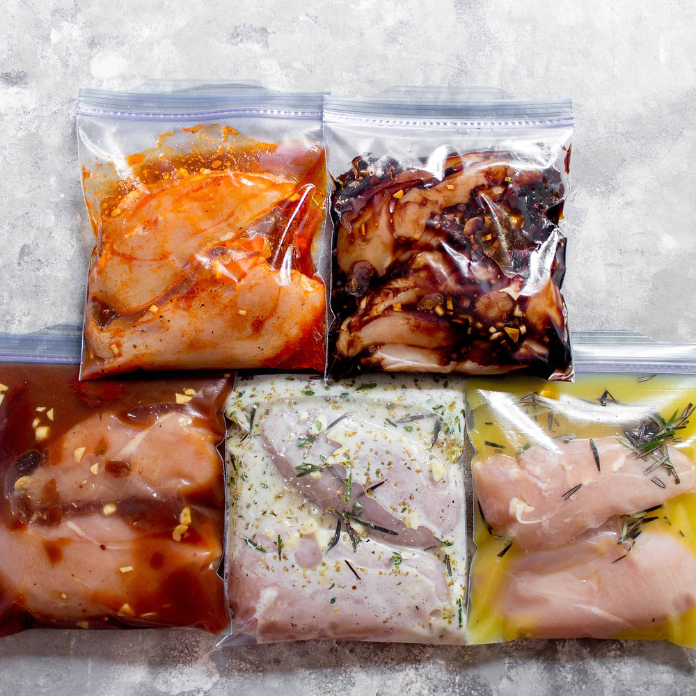 bags containing chicken with various marinades