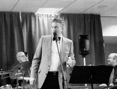San Diego Int'l Airport. Llew Matthews (Nancy Wilson's) conductor/ arranger smiling at bassist Bill Andrews