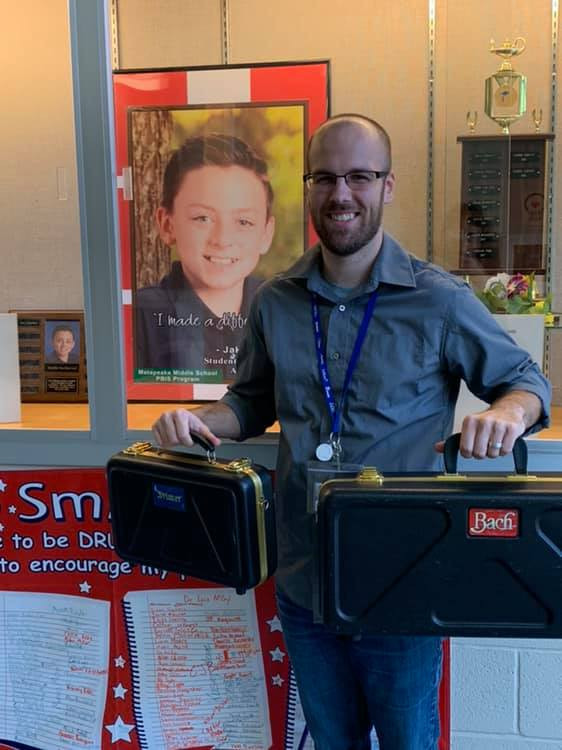 Giving Donated instruments to Mr. Kefer at Matapeake Middle School
