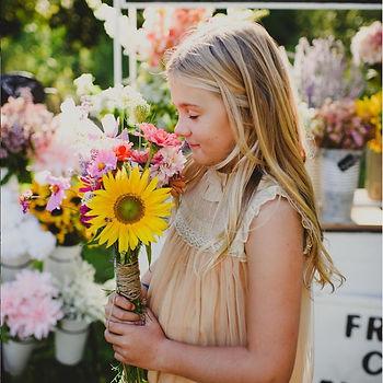 Girl holding wild flowers