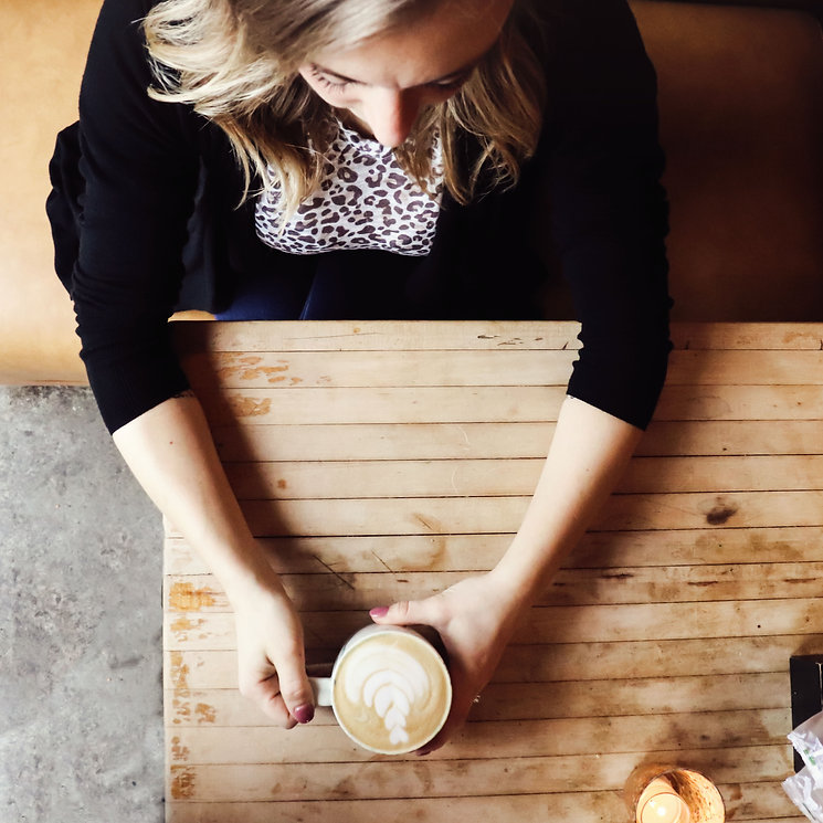 Amye drinking coffee, working on digital marketing