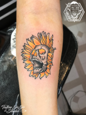 flower skull tattoo.jpg