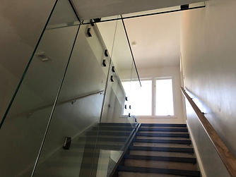 glass railing with steps up view normans