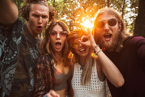 Photo of cheerful hippies men and women