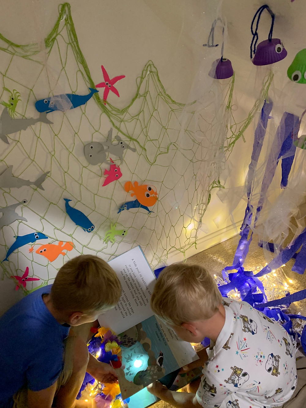 Secrets of the Sea Shine-A-Light book in our underwater cave (aka under the stairs)