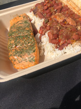 HERBED SMOKED SALMON  A happy customer took this photo at one of our pop-ups. They opted to have their made-to-order salmon with a favorite, our red beans and rice.