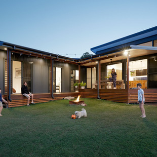 This warm family home presents a robust exterior to meet the bushfire requirements of a BAL29 rating. Touches of Spotted Gum cladding and battening bring warmth to the custom orb cladding in Colorbond Monument. The separate pavilions for living and sleeping are joined internally by a small breezeway, and this junction of pavilions creates a private courtyard for all the family to enjoy. Photography by www.philgallagher.com