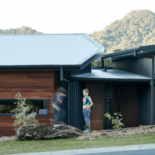 This warm family home presents a robust exterior to meet the bushfire requirements of a BAL29 rating. Touches of Native Spotted Gum cladding bring warmth to the custom orb cladding in Colorbond Monument. The separate pavilions for living and sleeping are stepped to follow the slope of the site and are joined internally with a small breezeway to help promote natural ventilation through the house. Living areas are oriented to maximise light and views.
