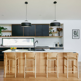 Blackbutt and Laminated Plywood Joinery creates a warm but modern kitchen with an Asian feel. Photography by www.philgallagher.com