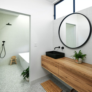 This Japanese inspired bathroom features a vanity room that leads through to a separate wash room. The bath enjoys a view out to the garden and a skylight above. Photography by www.philgallagher.com