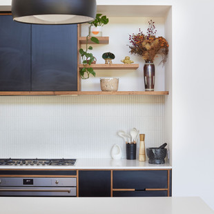 The Blackbutt and Laminated Plywood cabinetry is offset by the crispness of the composite stone benchtop and the texured finger tile splashback in this modern Japanese inspired home. Photography by www.philgallagher.com