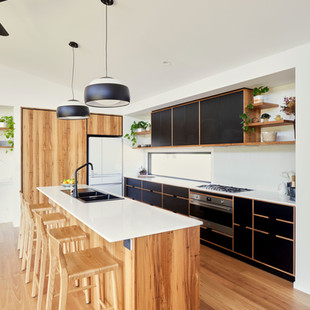 This earthy yet modern japanese inspired kitchen features blackbutt timber and laminated plywood cabinetry, with a composite stone benchtop. Photography by www.philgallagher.com