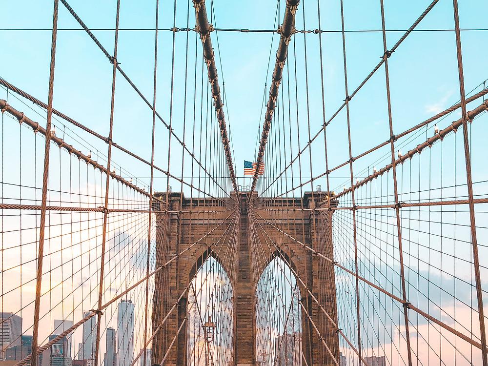 Brooklyn Bridge arch with USA flag