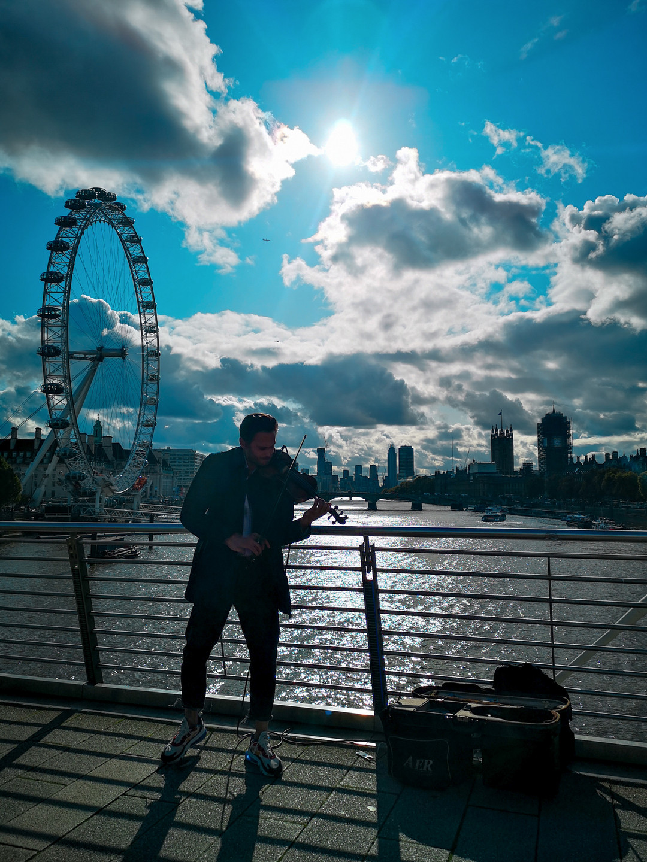 Busker on Bridge, London Eye