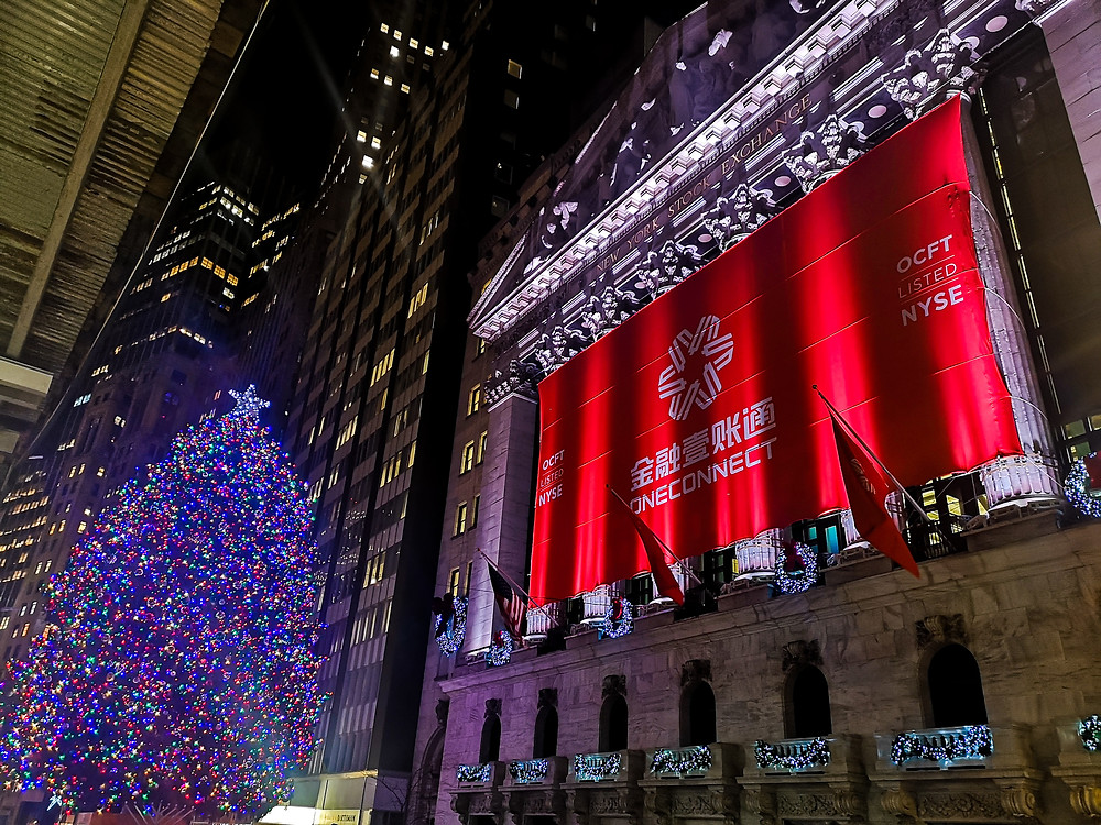 New York Stock Exchange building and Christmas tree at night time in the Financial District, New York