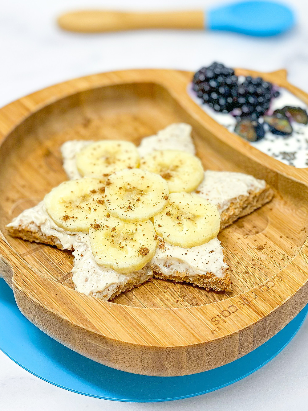 WHIPPED PEANUT BUTTER & BANANA TOAST in ladybird bamboo plate fromm Eco Rascals