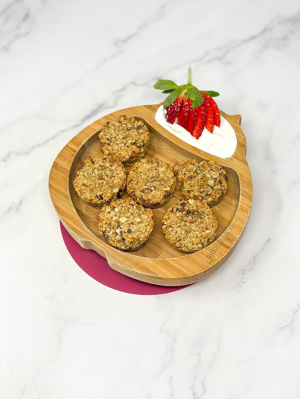 BANANA & OAT CUPS served in a bamboo kids plate ladybird