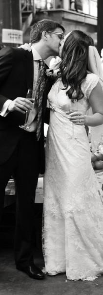Bride and Groom kissing in market.jpg