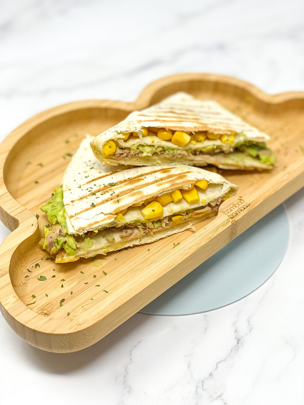 QUESADILLA HACK served in bamboo cloud plate