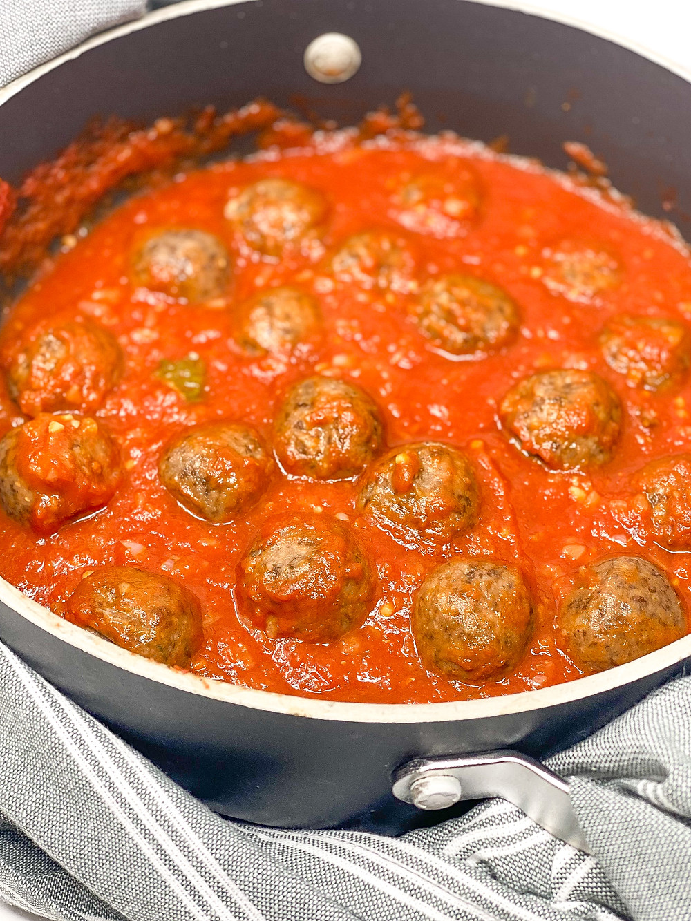 LENTIL BALLS WITH TOMATO SAUCE  cooking in the pan