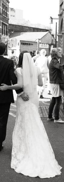 Bride and Groom walking in market.jpg