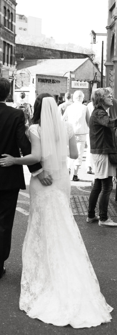 Bride and Groom walking in market.jpg