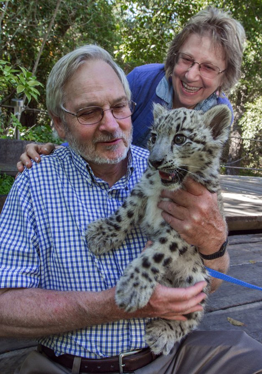 Dr. Rodney Jackson and his wife, Darla with snow leopard cub Jackson. Photo credit: Robbi Pengally