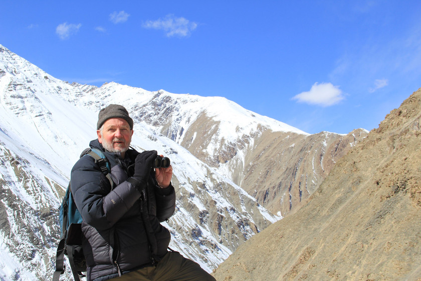 Dr. Rodney Jackson in front of the mountains in Hemis National Park in Ladakh, India in 2013. Photo Credit: Karen Czekalski