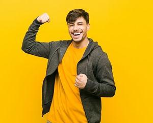 young-hispanic-casual-man-raising-fist-a