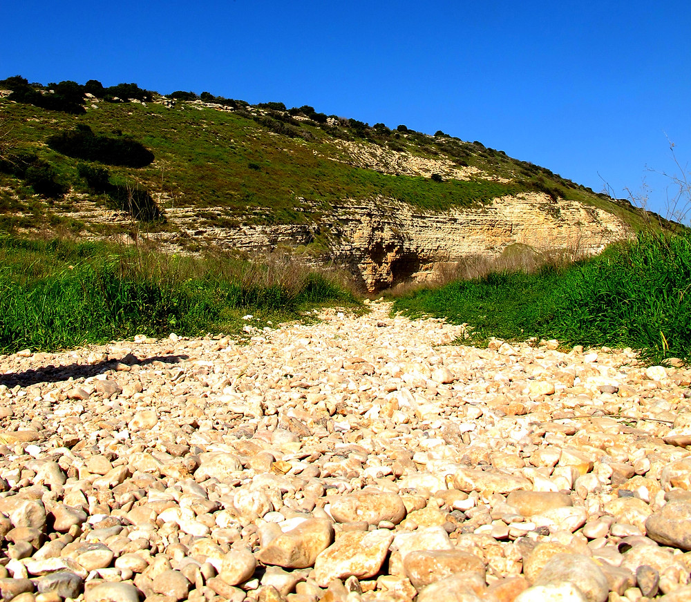 Smooth stones in the dried riverbed at the Valley of Elah where David conquered the giant
