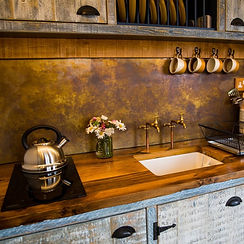Rustic Shepherds Hut Kitchen with Brass Splashback
