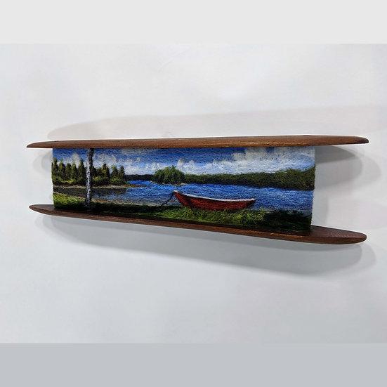 Row Boat on Shore in Shuttle
