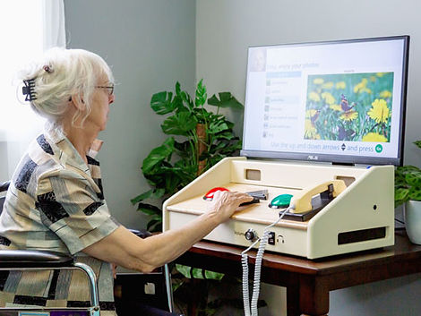 A woman living with dementia communicating using GENIE®