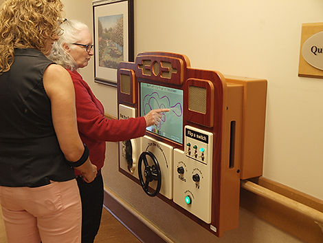 Recreational therapist helping woman living with dementia to use ABBY®