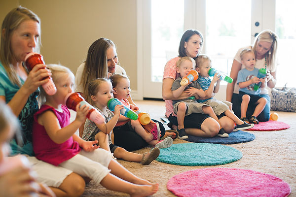 Kids and Parents sitting and singing together