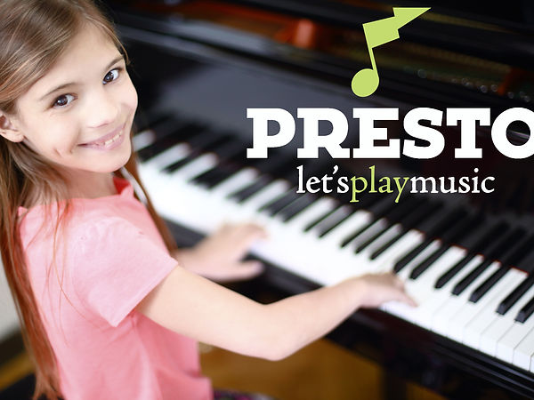 Girl Smiling while playing piano