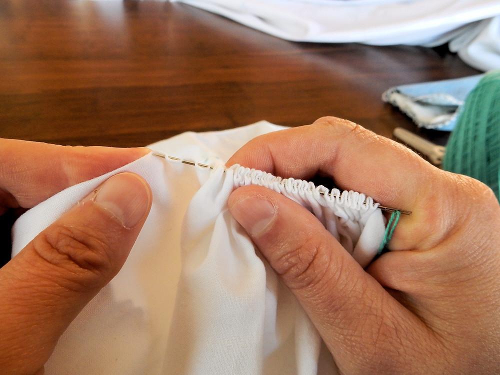 Use base of finger to brace needle while stitching.