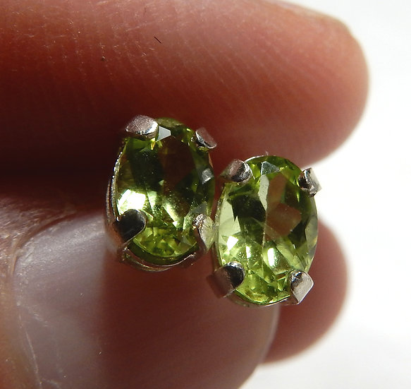 close up of peridot in sterling silver ear studs