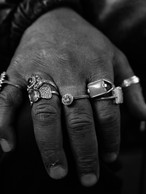 Marty Minnesota (nickname) with his hand full of rings placed on his knee. He was returning back to Minneapolis from a trip on the west coast, 2019.