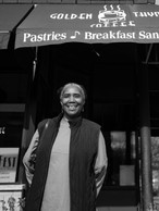 Ms. Stephanie is the owner of Golden Thyme Café standing outside of the café's old location in the Rondo neighborhood of St. Paul, Minnesota. The new location is across the street located on Selby. This black neighborhood was destroyed in the mid-1900s because of the construction of I-94, 2019.