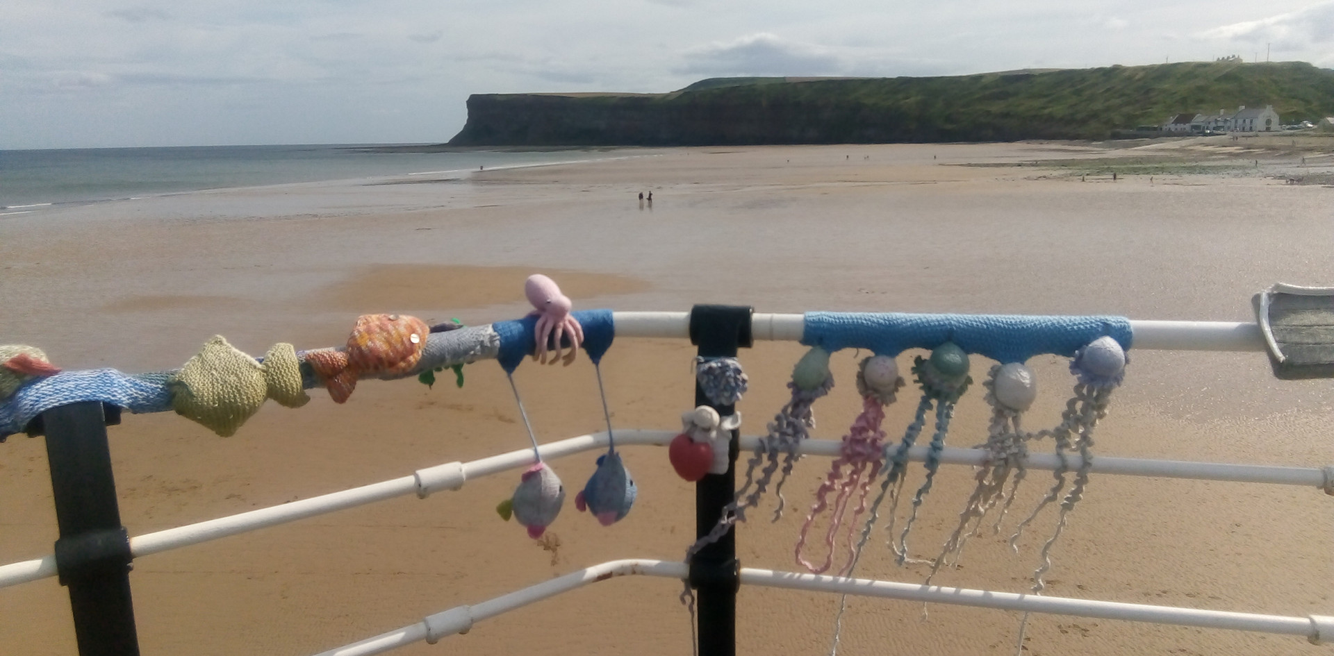 Knitted decorations on the pier