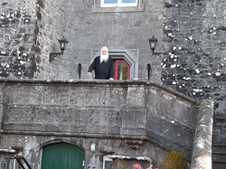 Fr Norman at front door of castle
