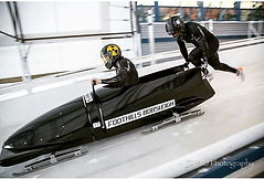 Sports therapist Ashley Watson pushing a 2man bobsleig for GB in Calgary, Canada.