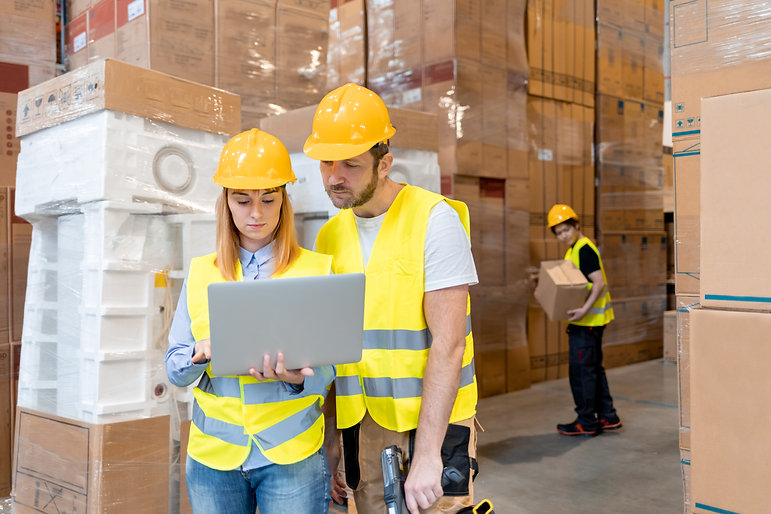 warehouse-workers-consult-delivery-plans