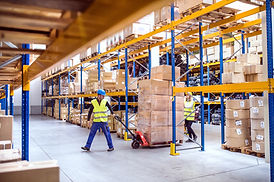warehouse-workers-pulling-a-pallet-truck