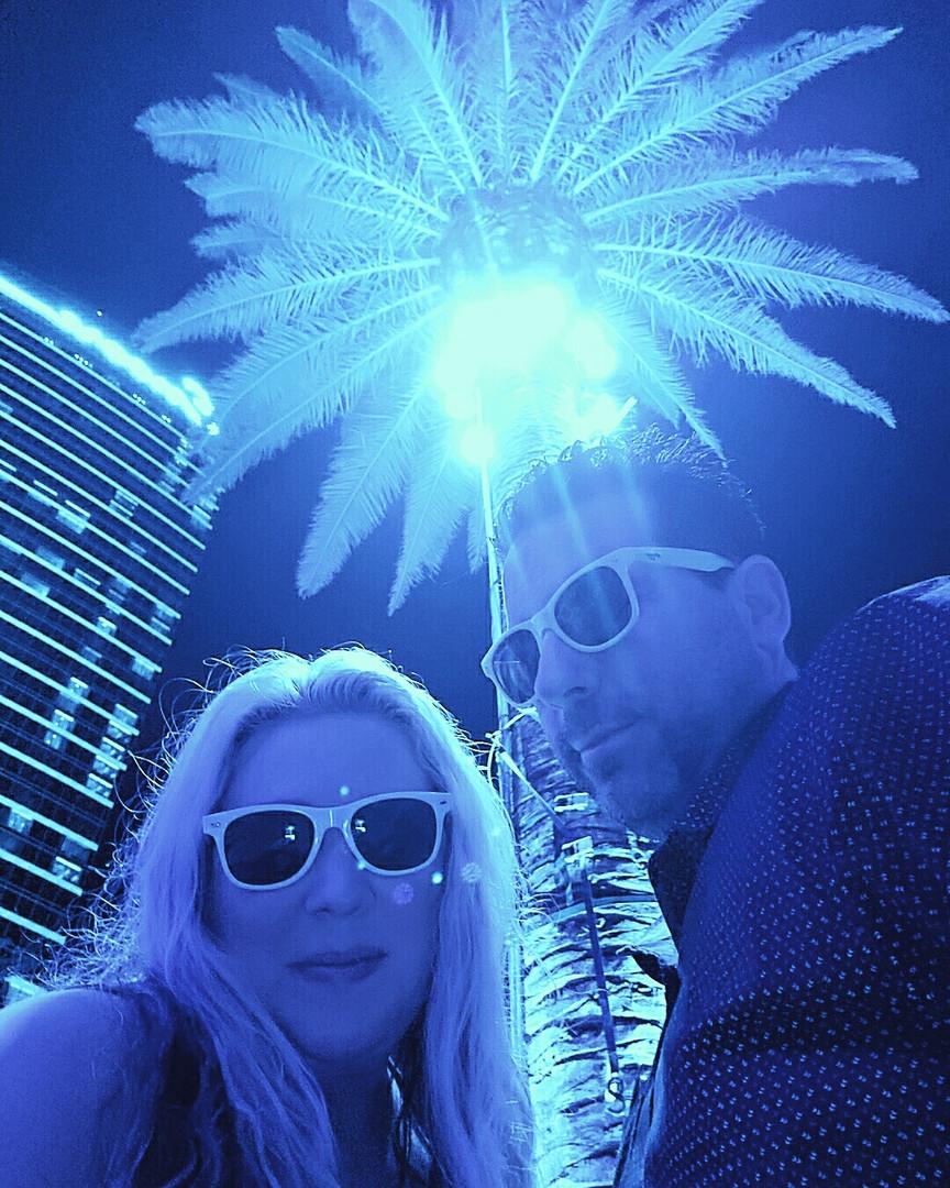 Vegas Couple Pool Party Blue Palm Trees.