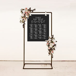 wedding seating chart table plan with modern calligraphy in black and white